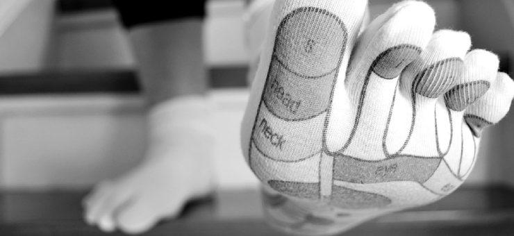 Quais são os benefícios de massagear os pés?